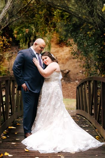 Sarah Williams of Mirror's Edge Photography and San Luis Obispo and Santa Barbara Wedding Photographer captures the Ochoa Wedding. Bride and Groom at Miguelito Park Bridge romantic.