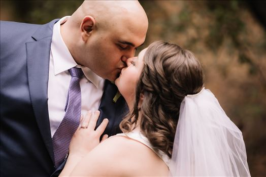 Sarah Williams of Mirror's Edge Photography and San Luis Obispo and Santa Barbara Wedding Photographer captures the Ochoa Wedding.  Bride and Groom kiss in Miguelito Park.