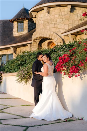 Sarah Williams of Mirror's Edge Photography captures the gorgeous fairy tale wedding day of Victoria and Esteban at the Castle Noland Wedding Venue in San Luis Obispo, California.  Bride and Groom at sunset in front of Castle Noland romatic
