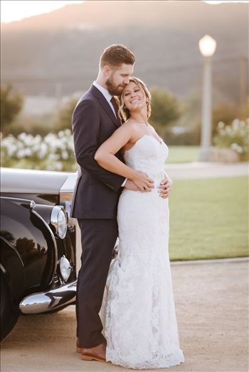 White Barn in Edna Valley rustic chic wedding by Mirror's Edge Photography, San Luis Obispo County Wedding and Engagement Photographer.  Sunset elegance with Rolls Royce and Bride and Groom in front of the White Barn in Edna Valley California.
