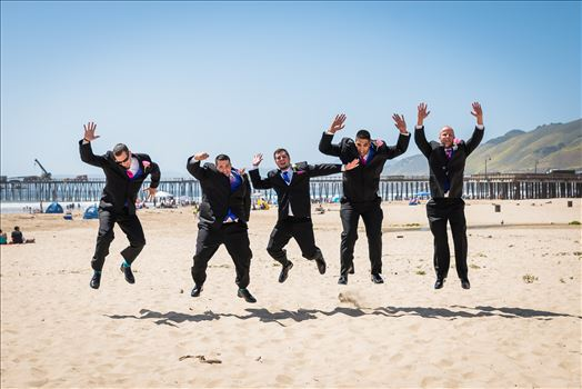 Sea Venture Resort and Spa Wedding Photography by Mirror's Edge Photography in Pismo Beach, California. Groom and Groomsmen jumping