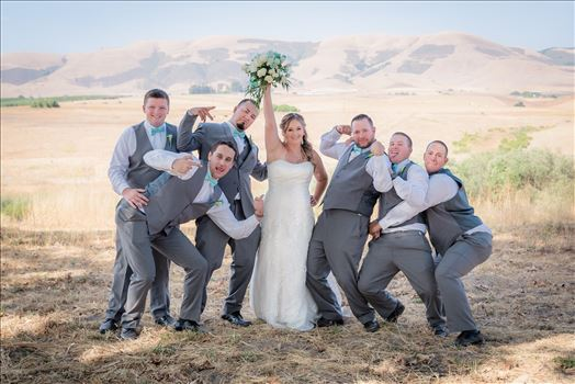 Mirror's Edge Photography, a San Luis Obispo Wedding Photographer, captures a wedding at the Historic Dana Adobe in Nipomo California.  Fun bride and groomsmen.