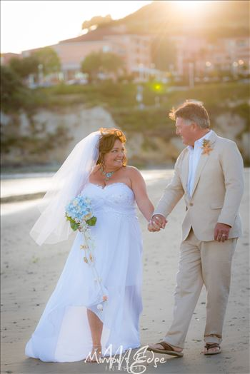 Beautiful and sweet wedding photography by the sea.  Ocean front ceremony at the Avila Lighthouse Suites on Avila Beach, California