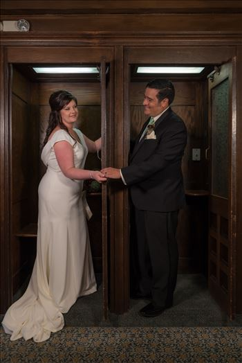 Wedding photography at the Historic Santa Maria Inn in Santa Maria, California by Mirror's Edge Photography. Bride and Groom in vintage phone booths inside of the Santa Maria Inn.