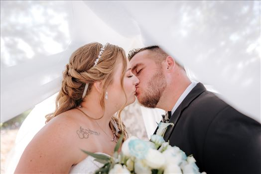 Mirror's Edge Photography, a San Luis Obispo Wedding Photographer, captures a wedding at the Historic Dana Adobe in Nipomo California.  Romantic bride and groom under the veil kiss