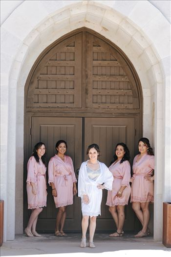 Mirror's Edge Photography captures Edith and Kyle's wedding at the Tooth and Nail Winery in Paso Robles California. Bride and her bridesmaids by the door