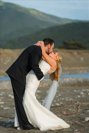 Ragged Point Inn Wedding Elopement photography by Mirror's Edge Photography in San Simeon Cambria California. Bride and groom dip on the sand. Big Sur Wedding Photography