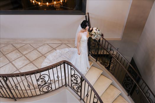 Mirror's Edge Photography captures Edith and Kyle's wedding at the Tooth and Nail Winery in Paso Robles California. Bride getting ready for the First Look on the stairs