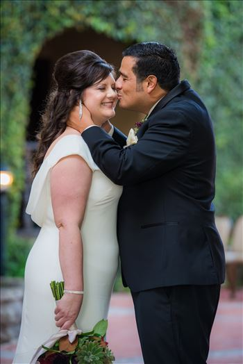 Wedding photography at the Historic Santa Maria Inn in Santa Maria, California by Mirror's Edge Photography. Bride and Groom Hidden Courtyard kiss.