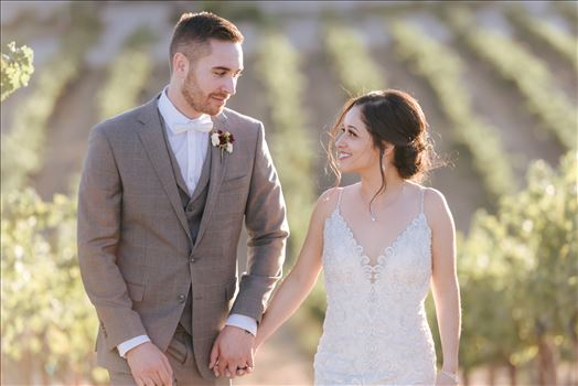 Tooth and Nail Winery elegant and formal wedding in Paso Robles California wine country by Mirror's Edge Photography, San Luis Obispo County Wedding Photographer. Bride and Groom walking through the vineyards in Paso Robles California wine country wedding