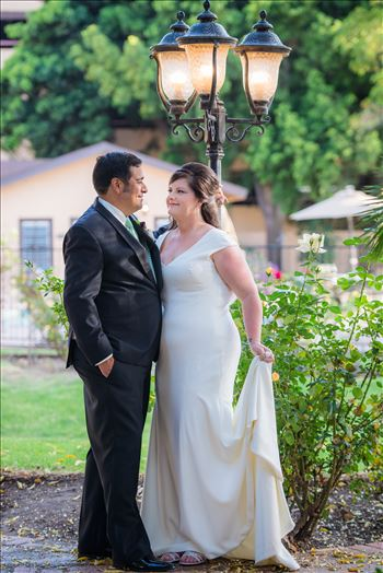 Wedding photography at the Historic Santa Maria Inn in Santa Maria, California by Mirror's Edge Photography. Bride and Groom at the lamppost near back lawn.