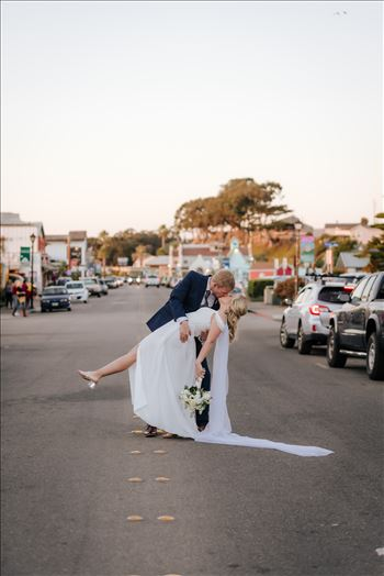 Sarah Williams of Mirror's Edge Photography, a San Luis Obispo Wedding and Engagement Photographer, captures Ryan and Joanna's wedding at the iconic Windows on the Water Restaurant in Morro Bay, California.  Stopping traffic with a dip and kiss