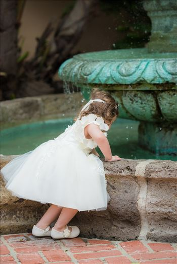 Wedding photography at the Historic Santa Maria Inn in Santa Maria, California by Mirror's Edge Photography. Flower girl in fountain.