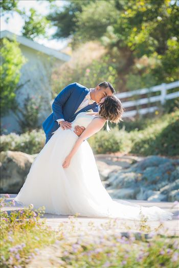 Mirror's Edge Photography captures Maryanne and Michael's magical wedding in the Secret Garden at the iconic Madonna Inn in San Luis Obispo, California. The dip kiss by the pond