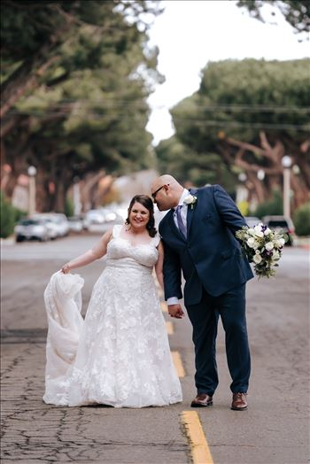 Sarah Williams of Mirror's Edge Photography and San Luis Obispo and Santa Barbara Wedding Photographer captures the Ochoa Wedding. Bride and Groom laughing in Downtown Lompoc.