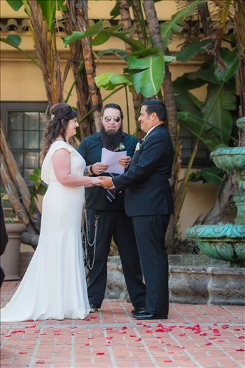 Wedding photography at the Historic Santa Maria Inn in Santa Maria, California by Mirror's Edge Photography. Bride and Groom exchange rings in courtyard