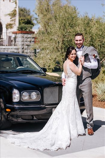 Mirror's Edge Photography captures Edith and Kyle's wedding at the Tooth and Nail Winery in Paso Robles California. Bride and Groom next to the getaway car