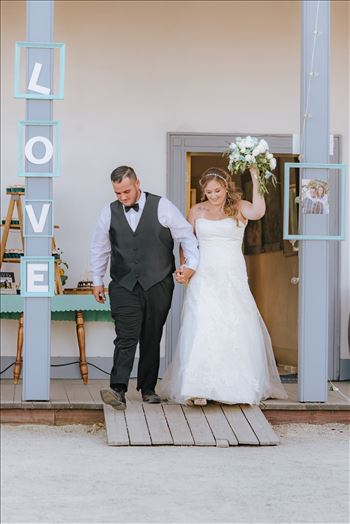 Mirror's Edge Photography, a San Luis Obispo Wedding Photographer, captures a wedding at the Historic Dana Adobe in Nipomo California.  Grand Entrance from the Dana Adobe.