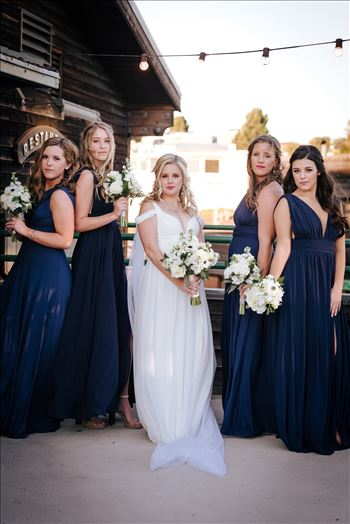 Sarah Williams of Mirror's Edge Photography, a San Luis Obispo Wedding and Engagement Photographer, captures Ryan and Joanna's wedding at the iconic Windows on the Water Restaurant in Morro Bay, California.  Bride and Bridesmaids outside of Windows.