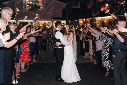 Mirror's Edge Photography, a San Luis Obispo Wedding and Engagement Photographer, captures Rashel and Brian's Wedding Day at the Madonna Inn in San Luis Obispo. Sparkler exit.