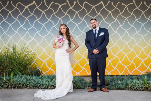 Wedding photography at the Kimpton Goodland Hotel in Santa Barbara California by Mirror's Edge Photography.  Bride and Groom by Retro Art Wall
