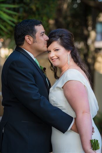 Wedding photography at the Historic Santa Maria Inn in Santa Maria, California by Mirror's Edge Photography.  Bride and groom show love.