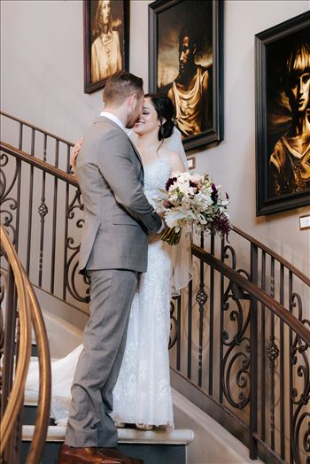 Mirror's Edge Photography captures Edith and Kyle's wedding at the Tooth and Nail Winery in Paso Robles California. First look on the staircase kiss.