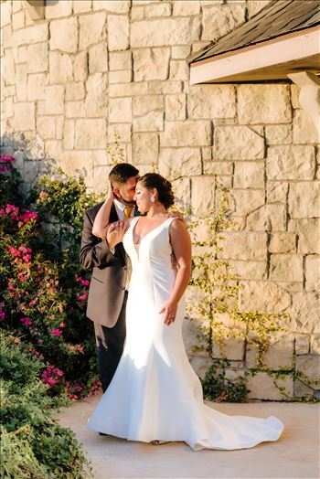 Sarah Williams of Mirror's Edge Photography captures the gorgeous fairy tale wedding day of Victoria and Esteban at the Castle Noland Wedding Venue in San Luis Obispo, California.  Bride and Groom at sunset in front of the castle