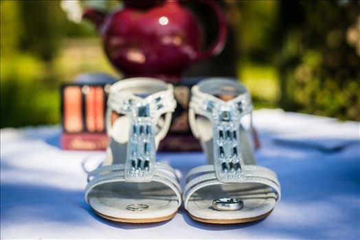Mirror's Edge Photography captures a high tea wedding at the Cypress Ridge Golf Club and Pavilion in Arroyo Grande, California.  Rings, shoes and a tea pot.
