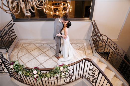 Mirror's Edge Photography captures Edith and Kyle's wedding at the Tooth and Nail Winery in Paso Robles California. Bride and Groom on the landing