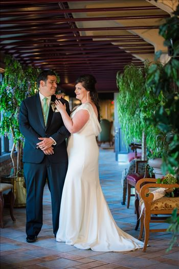 Wedding photography at the Historic Santa Maria Inn in Santa Maria, California by Mirror's Edge Photography. Bride and Groom in breezeway between the Taproom and the Front Desk at the Santa Maria Inn after wedding.