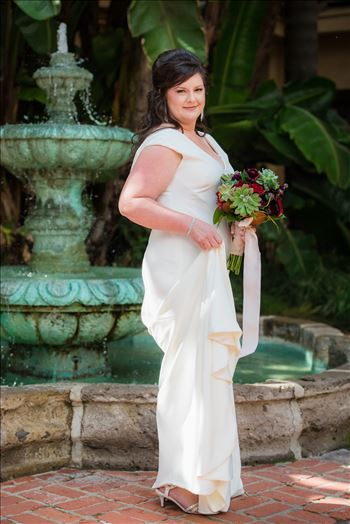 Wedding photography at the Historic Santa Maria Inn in Santa Maria, California by Mirror's Edge Photography. Bride by the fountain