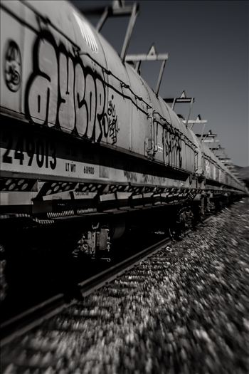 Graffiti on oil tankers and infinity train tracks