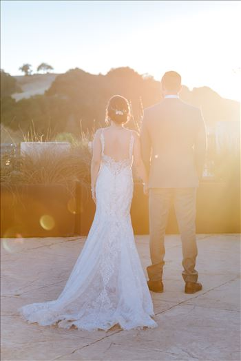 Mirror's Edge Photography captures Edith and Kyle's wedding at the Tooth and Nail Winery in Paso Robles California. Bride and groom watching the sunset