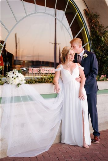 Sarah Williams of Mirror's Edge Photography, a San Luis Obispo Wedding and Engagement Photographer, captures Ryan and Joanna's wedding at the iconic Windows on the Water Restaurant in Morro Bay, California.  Bride and Groom at sunset
