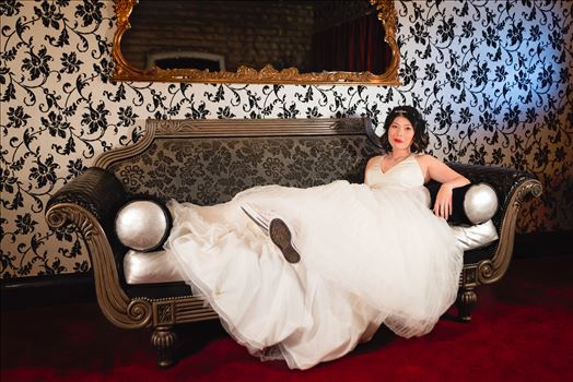Mirror's Edge Photography captures Maryanne and Michael's magical wedding in the Secret Garden at the iconic Madonna Inn in San Luis Obispo, California. The Bride on the couch in the Crystal Room