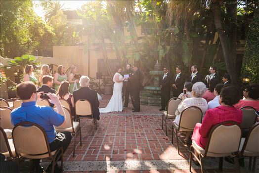Wedding photography at the Historic Santa Maria Inn in Santa Maria, California by Mirror's Edge Photography. Sunny day ceremony in the courtyard.