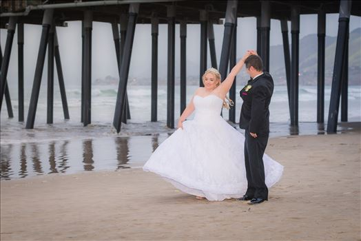 Sea Venture Resort and Spa Wedding Photography by Mirror's Edge Photography in Pismo Beach, California. Bride and Groom at Pismo Beach Pier