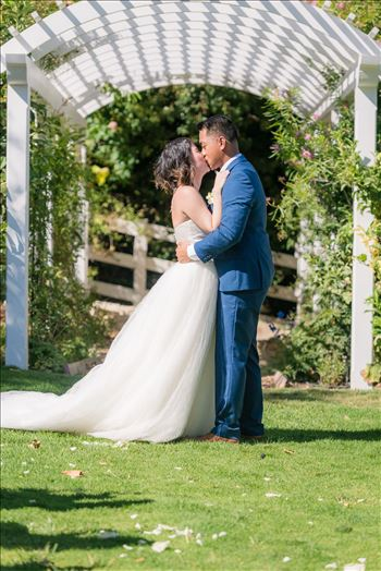Mirror's Edge Photography captures Maryanne and Michael's magical wedding in the Secret Garden at the iconic Madonna Inn in San Luis Obispo, California. The kiss in the secret garden